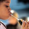 Izzy Morales, 8, watches as melted marshmallow stretches between her mouth and the s\'more she is eating. Morales is a Brownie in Trop 625. Edmond Girl Scouts made S\'mores, a popular winter snack, on a corner in downtown Edmond Saturday, Dec. 17, 2011, as a fundraiser for their troop. The Scouts, with Troop 625, used a griddle as their heat source to melt marshmallows on a skewer and sandwich it with a square of chocolate between two graham crackers. Money raised will help girls who want to join Scouts but require some financial assistance with the activity fees and various other costs involved in Scouting. This activity was part of a series of Downtown Edmond\' Christmas celebrations. Photo by Jim Beckel, The Oklahoman