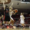 Oklahoma Sooner\'s Nicole Griffin (4) drives around Tech\'s Kelsi Baker (41) as the University of Oklahoma Sooners (OU) play the Texas Tech Lady Red Raiders in NCAA, women\'s college basketball at The Lloyd Noble Center on Saturday, Jan. 12, 2013 in Norman, Okla. Photo by Steve Sisney, The Oklahoman