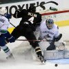 Photo - Dallas Stars defenseman Brenden Dillon, center, hits the goalpost while taking a shot on Vancouver Canucks goalie Cory Schneider, right, as Canucks' Keith Ballard, left, defends during the first period of an NHL hockey game on Thursday, April 18, 2013, in Dallas.  (AP Photo/Michael Mulvey)