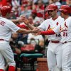 Photo - St. Louis Cardinals Matt Carpenter, center, celebrates with Peter Bourjos, left, and Allen Craig, right, after they scored on Michael Wacha's two-run single in the second inning of a baseball game against the Chicago Cubs Thursday, May 15, 2014, in St. Louis. (AP Photo/Sarah Conard)