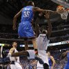 Oklahoma City\'s Kevin Durant (35) stays airborne, watching his dunk go down as Dallas center Brendan Haywood (33) lands. Photo by Bryan Terry, The Oklahoman ORG XMIT: KOD