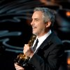 Photo - Alfonso Cuaron accepts the award for best director for