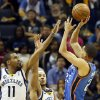 Oklahoma City\'s Kevin Martin (23) shoots against Memphis\' Mike Conley (11) and Jerryd Bayless (7) during Game 3 in the second round of the NBA basketball playoffs between the Oklahoma City Thunder and Memphis Grizzles at the FedExForum in Memphis, Tenn., Saturday, May 11, 2013. Memphis won, 87-81. Photo by Nate Billings, The Oklahoman