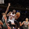 Photo - New York Knicks's Raymond Felton, center, shoots against Milwaukee Bucks' Ramon Sessions, left, as Giannis Antetokounmpo watches during the first quarter of an NBA basketball game at New York's Madison Square Garden, Saturday, March 15, 2014. (AP Photo/Richard Drew)