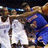 Oklahoma City\'s Serge Ibaka (9) knocks the ball away from New York\'s Carmelo Anthony (7) during an NBA basketball game between the New York Knicks and the Oklahoma City Thunder at Chesapeake Energy Arena in Oklahoma City, Sunday, Feb. 9, 2014. Photo by Nate Billings, The Oklahoman