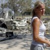 Steveanne Bielich stands by the remains of her home in northeast Oklahoma City, Wednesday, August 31, 2011. Bielich\'s home was destroyed by a wildfire on Tuesday, August 30, 2011. Photo by Bryan Terry, The Oklahoman