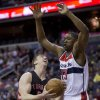 Photo - Toronto Raptors Tyler Hansbrough (50), is shaded by Washington Wizards Kevin Seraphin (13) of France during the first half of an NBA basketball game in Washington, Tuesday, Feb. 18, 2014. Hansbrough scored. (AP Photo/Manuel Balce Ceneta)