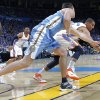 Denver\'s Danilo Gallinari (8) and Oklahoma City\'s Thabo Sefolosha (2) battle for a loose ball during the first round NBA playoff game between the Oklahoma City Thunder and the Denver Nuggets on Sunday, April 17, 2011, in Oklahoma City, Okla. Photo by Chris Landsberger, The Oklahoman