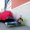 Susan Ellis reclines on her lawn chair as she holds her place as number two in line for Black Friday deals on Wednesday, Nov. 21, 2012 at Best Buy in Abilene, Texas. Ellis said she plans to wait outside the store until the doors open at midnight on Thursday, Nov. 22, 2012. Her husband will take her place in line long enough for Ellis to stop by her mother\'s home for a bite of Thanksgiving dinner. (AP Photo/Abilene Reporter-News, Joy Lewis)