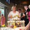 Photo - Nancy Levindowski reacts as her wedding cake is wheeled out after exchanging vows with Steve Keller at the Denny's restaurant on Fremont Street in Las Vegas, Wednesday, April 4, 2013. (AP Photo/Las Vegas Sun, Sam Morris)