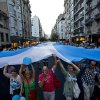 Protesters carry a large Argentine flag during an anti-government demonstration in Buenos Aires, Argentina, Thursday, Nov. 8, 2012. Thousands of people marched against rising inflation, crime, exchange controls and to express their fear to a constitutional reform that could open the way for a third consecutive reelection of Argentina\'s President Cristina Fernandez. (AP Photo/Victor R. Caivano)