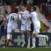 Photo - Real's Cristiano Ronaldo, centre, celebrates his goal with teammate Gareth Bale, right, during a Spanish La Liga soccer match between Atletico de Madrid and Real Madrid at the Vicente Calderon stadium in Madrid, Spain, Sunday, March 2, 2014. (AP Photo/Andres Kudacki)