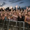 Photo - FILE - This Aug. 3, 2013 file photo shows fans reacting while Mumford & Sons performs at the Lollapalooza Festival in Chicago. Lollapalooza marks its 10th anniversary in Chicago when it opens for three days starting Friday, Aug. 1, 2014, with a lineup including Eminem, Outkast and Kings of Leon. Lollapalooza became the basis for the modern festival culture and circuit that has evolved since, including events like Bonnaroo, Coachella and a legion of smaller multi-day parties. (AP Photo/Scott Eisen, File)
