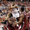 COLLEGE BASKETBALL: Oklahoma State University (OSU) Cowboys\' Stephen Graham (21) controls a rebound vs. Southern Illinois in the second round of the NCAA Tournament at the Ford Center in Oklahoma City, March 20, 2005. By Nate Billings/The Oklahoman.