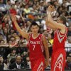 Photo - Houston Rockets Jeremy Lin (7) cheers with Francisco Garcia after scoring against the Indiana Pacers during a preseason game in Taipei, Taiwan, Sunday, Oct. 13, 2013. The Rockets beat the Pacers 107-98. (AP Photo/Wally Santana)