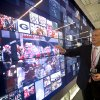 College Football Hall of Fame CEO and president John Stephenson demonstrates an interactive display entitled