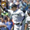 Photo - Seattle Mariners' Logan Morrison, center, is congratulated by Chris Taylor, left, and followed by Kyle Seager on Morrison's three-run home run against the Atlanta Braves in the third inning of a baseball game Wednesday, Aug. 6, 2014, in Seattle. (AP Photo/Elaine Thompson)