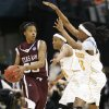 NCAA TOURNAMENT, WOMEN\'S COLLEGE BASKETBALL: Texas A&M University\'s Danielle Gant (55), left, tries to pass the ball around Alexis Hornbuckle (14), middle, and Alberta Auguste (33) of Tennessee in the second half during the NCAA Women\'s Basketball Tournament regional final between Tennessee and Texas A&M at the Ford Center in Oklahoma City, Tuesday, April 1, 2008. Tennessee won, 53-45. BY NATE BILLINGS, THE OKLAHOMAN