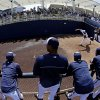 Players watch as Milwaukee Brewers starting pitcher Matt Garza warms up before an exhibition spring training baseball game against the San Diego Padres Friday, March 7, 2014, in Phoenix. (AP Photo/Morry Gash)