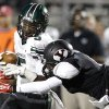 Norman North\'s Nick Basquine is tackled by Yukon\'s Nick Bryant during a high school football game between Yukon and Norman North in Yukon, Okla., Friday, Oct. 4, 2013. Photo by Sarah Phipps, The Oklahoman