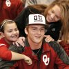 Justice Hansen gets hugs from his mom, Kara, and his sister, Acyn, 6, after he signed the letter. Justice Hansen is an Edmond Santa Fe quarterback who signed a letter of intent to play football with OU during signing day ceremony in the gymnasium at Edmond Santa Fe High School on Wednesday, Feb. 5, 2014. Photo by Jim Beckel, The Oklahoman