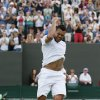Photo - Jo-Wilfried Tsonga of France celebrates winning against Jimmy Wang of Chinese Taipei in their men's singles match at the All England Lawn Tennis Championships in Wimbledon, London, Friday, June 27, 2014. (AP Photo/Alastair Grant)