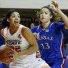 Oklahoma State\'s Brittney Martin (22) tries to get past Kansas\' Monica Engelman (13) during a women\'s college basketball game between Oklahoma State University (OSU) and Kansas at Gallagher-Iba Arena in Stillwater, Okla., Tuesday, Jan. 8, 2013. Photo by Bryan Terry, The Oklahoman