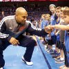 Oklahoma City\'s Derek Fisher (6) fist bumps Drew Kent, 3, of Edmond before Game 5 in the first round of the NBA playoffs between the Oklahoma City Thunder and the Houston Rockets at Chesapeake Energy Arena in Oklahoma City, Wednesday, May 1, 2013. Photo by Sarah Phipps, The Oklahoman