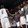 Oklahoma City\'s Hasheem Thabeet (34), Kendrick Perkins (5) and Kevin Martin (23) celebrate with Serge Ibaka (9) after a play during an NBA basketball game between the Oklahoma City Thunder and the San Antonio Spurs in Oklahoma City Monday, Dec. 17, 2012. Oklahoma City won, 107-93. Photo by Nate Billings, The Oklahoman