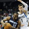 Charlotte Bobcats\' Kemba Walker, left, drives around Minnesota Timberwolves\' Alexey Shved, of Russia, in the second half of an NBA basketball game, Wednesday, Nov. 14, 2012, in Minneapolis. The Bobcats won 89-87. Walker scored 22 points to lead the Bobcats. (AP Photo/Jim Mone)
