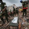 A stretcher with a body bag is placed on standby while workers toil in the collapsed garment factory building Tuesday April 30, 2013 in Savar, near Dhaka, Bangladesh. Emergency workers hauling large concrete slabs from a collapsed 8-story building said Tuesday they expect to find many dead bodies when they reach the ground floor, indicating the death toll will be far more than the official 386. One estimate said it could be as high as 1,400. The illegally constructed, 8-story Rana Plaza collapsed on the morning of April 24, bringing down the five garment factories inside.(AP Photo/Wong Maye-E)