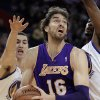Los Angeles Lakers\' Pau Gasol (16) looks to shoot against Golden State Warriors\' Klay Thompson, left, and Mickell Gladness during the first half of an NBA basketball game Wednesday, April 18, 2012, in Oakland, Calif. (AP Photo/Ben Margot)
