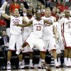 From left, OU\'s Taylor Griffin, Ryan Wright, Willie Warren, Blake Griffin, and Tony Crocker celebrate near the end of their win in a first round game of the men\'s NCAA tournament between Oklahoma and Morgan State in Kansas City, Mo., Thursday, March 19, 2009. PHOTO BY BRYAN TERRY