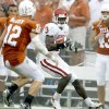Photo - OU's Reggie Smith runs the ball after an interception as Colt McCoy of Texas runs after him during the second half of the college football game between the University of Oklahoma Sooners (OU) and the University of Texas Longhorns (UT) at the Cotton Bowl on Saturday, Oct. 6, 2007, in Dallas, Texas.  By Bryan Terry, The Oklahoman    ORG XMIT: KOD