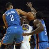 The Golden State Warriors\' Festus Ezeli (31) is double teamed by the Oklahoma City Thunder\'s Thabo Sefolosha (2) and Kendrick Perkins (5) at Oracle Arena in Oakland, California, on Wednesday, January 23, 2013. (Jane Tyska/Oakland Tribune/MCT) ORG XMIT: 1134056