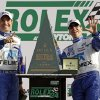 Driver\'s Memo Rojas, left, of Mexico, and Scott Pruett celebrate next to the championship trophy after winning Grand-Am Series Rolex 24 hour auto race at Daytona International Speedway, Sunday, Jan. 27, 2013, in Daytona Beach, Fla. (AP Photo/John Raoux)