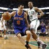 New York Knicks point guard Pablo Prigioni (9) looks to get around Boston Celtics\' Avery Bradley during the second quarter of Game 3 of a first-round NBA basketball playoff series in Boston, Friday, April 26, 2013. (AP Photo/Winslow Townson)