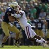 Notre Dame\'s Andrew Hendrix, left, is tackled by Oklahoma\'s Corey Nelson (7) during the first half of an NCAA college football game on Saturday, Sept. 28, 2013, in South Bend, Ind. (AP Photo/Darron Cummings) ORG XMIT: INDC109