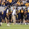 West Virginia quarterback Geno Smith walks off the field after a turnover on downs during an NCAA college football game against Kansas State in Morgantown, W.Va., Saturday, Oct. 20, 2012. Kansas State won 55-14. (AP Photo/Christopher Jackson) ORG XMIT: WVCJ120