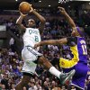 Photo - Boston Celtics forward Jeff Green (8) shoots over Los Angeles Lakers center Dwight Howard, right, during the first quarter of an NBA basketball game in Boston, Thursday, Feb. 7, 2013. (AP Photo/Charles Krupa)