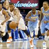 Oklahoma City\'s Thabo Sefolosha gets a loose ball and takes in down the court while Russell Westbrook and Denver\'s Raymond Felton and Kenyon Martin follow during the first round NBA Playoff basketball game between the Thunder and the Nuggets at OKC Arena in downtown Oklahoma City on Wednesday, April 20, 2011. The Thunder beat the Nuggets 106-89 and lead the series 2-0. Photo by John Clanton, The Oklahoman