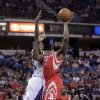 Photo - Houston Rockets guard James Harden, right, goes to the basket against   Sacramento Kings guard Marcus Thornton during the first quarter of an NBA basketball game in Sacramento, Calif., Sunday, Feb. 10, 2013.(AP Photo/Rich Pedroncelli)
