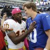 Washington Redskins quarterback Robert Griffin III (10) greets New York Giants quarterback Eli Manning after their NFL football game, Sunday, Oct. 21, 2012, in East Rutherford, N.J. The Giants won 27-23. (AP Photo/The Record of Bergen County, Tyson Trish) MAGS OUT; TV OUT; NO ARCHIVING; MANDATORY CREDIT