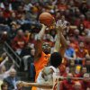 Oklahoma State\'s Marcus Smart takes a shot over Iowa Statre\'s Will Clyburn during 2nd half at Hilton Coliseum Wednesday, March 6, 2013, in Ames, Iowa. Photo by Nirmalendu Majumdar/Ames Tribune