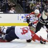 Photo - Florida Panthers' Tim Thomas, left, makes a save as teammate Shawn Matthias, center, and Columbus Blue Jackets' Mark Letestu try to control the puck during the second period of an NHL hockey game on Saturday, Feb. 1, 2014, in Columbus, Ohio. (AP Photo/Jay LaPrete)