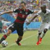Germany\'s Miroslav Klose, left, and United States\' DaMarcus Beasley challenge for the ball during the group G World Cup soccer match between the USA and Germany at the Arena Pernambuco in Recife, Brazil, Thursday, June 26, 2014. (AP Photo/Matthias Schrader)