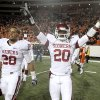 Oklahoma\'s Travis Lewis (28) and Quinton Carter (20) celebrate the Sooner\'s win of the college football game between the University of Oklahoma Sooners (OU) and Oklahoma State University Cowboys (OSU) at Boone Pickens Stadium on Saturday, Nov. 29, 2008, in Stillwater, Okla. STAFF PHOTO BY SARAH PHIPPS