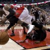 Photo - Toronto Raptors guard Terrence Ross tumbles over Brooklyn Nets Paul Pierce during the first half of Game 5 of the opening-round NBA basketball playoff series in Toronto, Wednesday, April 30, 2014. (AP Photo/The Canadian Press, Frank Gunn)