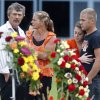 Photo - Mourners gather after a funeral for race car driver Kevin Ward Jr. outside South Lewis Central School, Thursday, Aug. 14, 2014, in Turin, N.Y. Ward died after being struck by NASCAR driver Tony Stewart's car during a race last weekend at a dirt track in western New York. (AP Photo/Mike Groll)