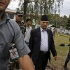 Nepal\'s Prime Minister Baburam Bhattarai, second right, walks escorted by security officers after meeting with leaders of major political parties in Katmandu, Nepal, Thursday, May, 3, 2012. In a last-ditch effort to finish years of work on Nepal\'s new constitution, Prime Minister Bhattarai will dissolve his Cabinet and form a new coalition government that includes members of the main opposition parties, an aide said Thursday. (AP Photo/Binod Joshi)